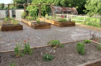 Brick-paved-patio-and-raised-beds-Norfolk